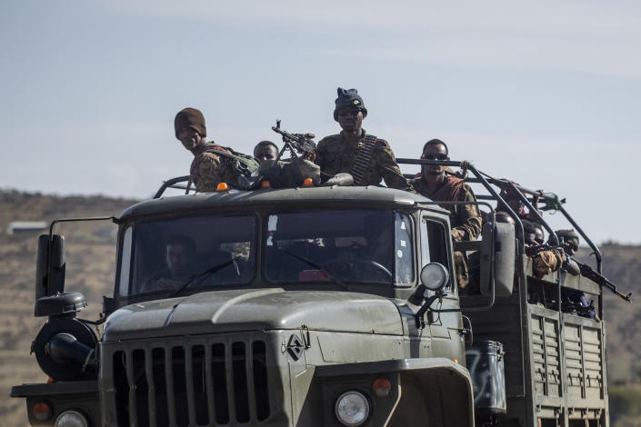 Ethiopian government soldiers ride in the back of a truck on a road near Agula, in the Tigray region of northern Ethiopia, on Saturday, May 8, 2021. As the Tigray People's Liberation Front and the government forces fight, civilians, and especially children, are suffering heavily. (AP Photo/Ben Curtis)
