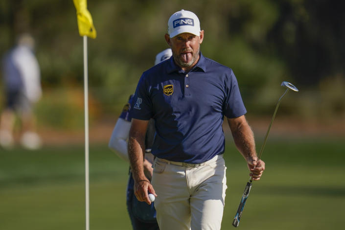 Lee Westwood, of England, reacts after making a putt on the 16th hole during the final round of The Players Championship golf tournament Sunday, March 14, 2021, in Ponte Vedra Beach, Fla. (AP Photo/Gerald Herbert)