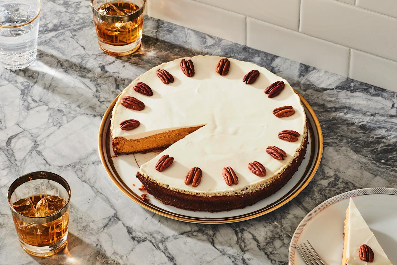 """The caramelized flavor of bourbon and the tang of sour cream add balance to the rich, spiced filling of this cheesecake. Chopped pecans add a nutty dimension to the graham cracker crust. <a href=""""https://www.epicurious.com/recipes/food/views/pumpkin-cheesecake-with-bourbon-sour-cream-topping-13386?mbid=synd_yahoo_rss"""">See recipe.</a>"""