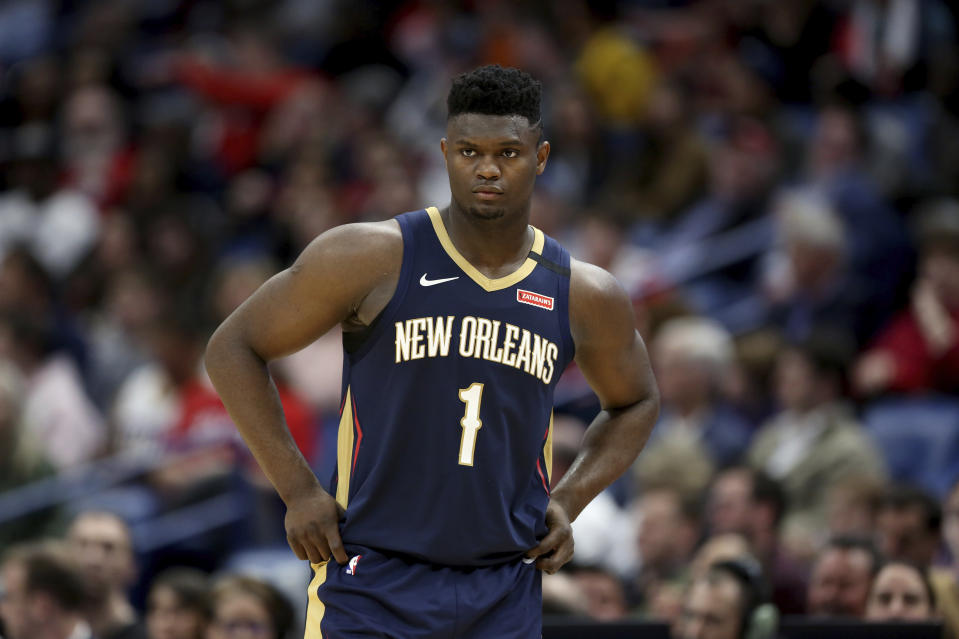 New Orleans Pelicans forward Zion Williamson walks onto the court during the second half of the team's NBA basketball game against the Miami Heat in New Orleans, Friday, March 6, 2020. (AP Photo/Rusty Costanza)