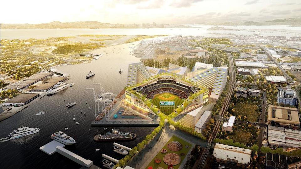 An aerial view of the A's stadium shows high rises surrounding the stadium, a rooftop park and baseball by the water. (Athletics)
