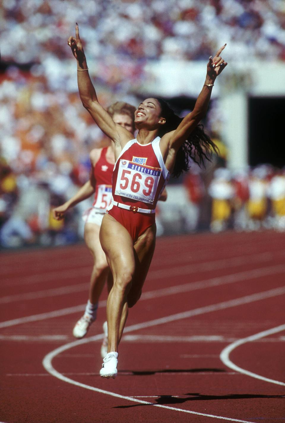 No other Olympian had or has as much style, charisma, or athletic prowess than Florence Griffith-Joyner. And if that name doesn't ring a bell, maybe her nickname FloJo will. Griffith-Joyner took home three gold medals, as well as a silver, at the Seoul Olympics in 1988. FloJo also broke the world record for the 100-meter race even before stepping onto the Olympic track. (Mike Powell/Allsport)