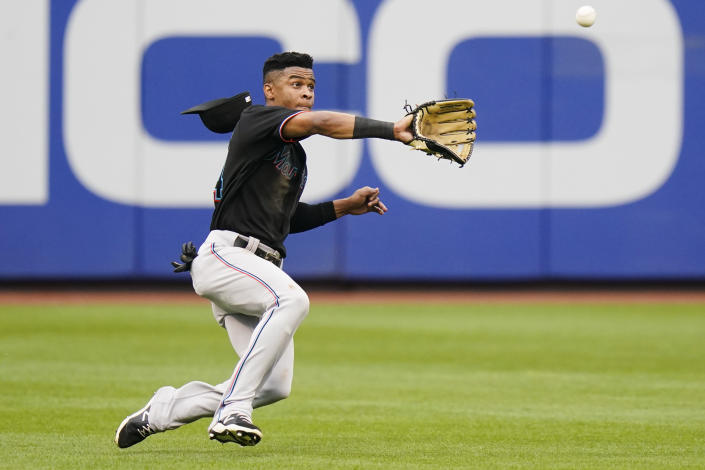 Miami Marlins' Magneuris Sierra catches a ball hit by New York Mets' Francisco Lindor for an out during the third inning in the first baseball game of a doubleheader Tuesday, Sept. 28, 2021, in New York. (AP Photo/Frank Franklin II)