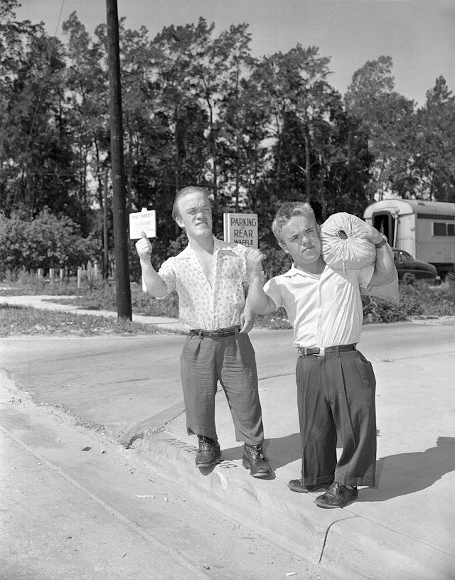 <p>Roy Smith, left, and Harry Burman, right, two dwarfes from London, formerly with Ringling Bros., Barnum and Bailey Circus, get set for a long trip, maybe not to London, but somewhere for a job. They arrived aboard the train returning to circus winter quarters in Sarasota, Fla., July 20, 1956. (AP Photo) </p>
