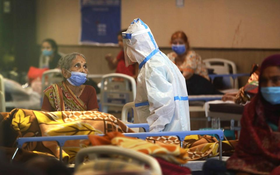 A health worker talks to a woman in a quarantine centre for Covid patients in New Delhi - AP