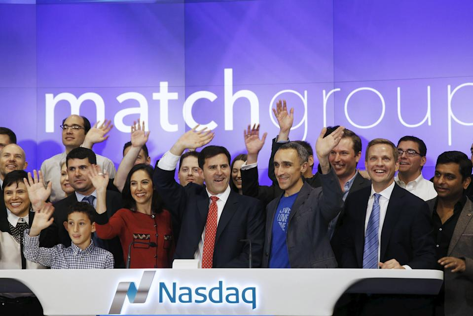 Greg Blatt (center), chairman of Match Group, and Sam Yagan (third from the right), then CEO of Match Group, celebrate Match Group's IPO at the NASDAQ in New York on Nov. 20, 2015. (REUTERS/Lucas Jackson)