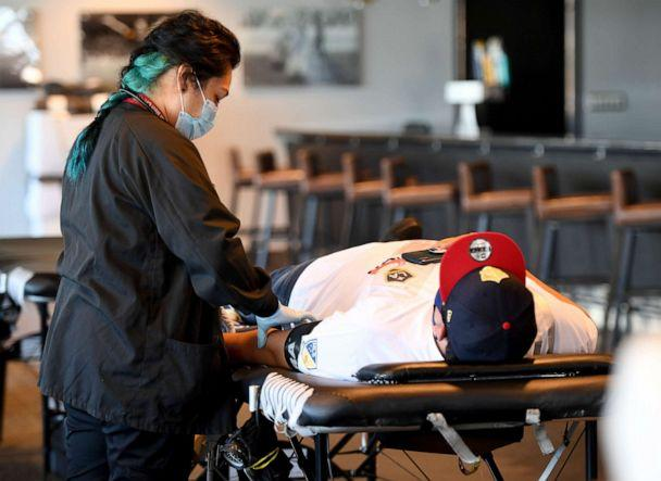 PHOTO: Edith B. Fernandez draws blood from Luis Fregoso inside the Stadium club at Dignity Health Sports Park in Carson, Calif, May 21, 2020. (Medianews Group/long Beach Press/MediaNews Group via Getty Images)