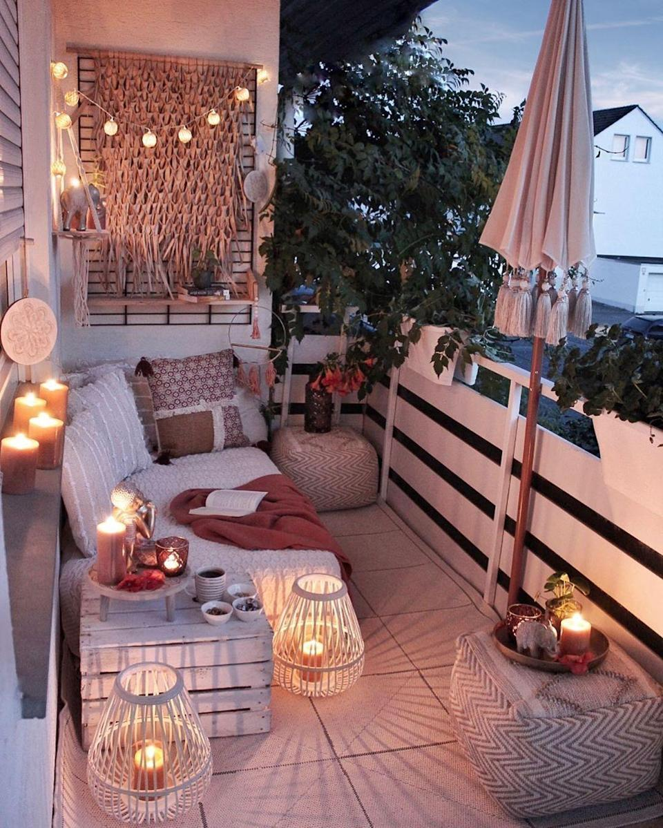 """<p>With paper grass wall hangings, straw lanterns, woven pillows and ottomans, this well-lit balcony is a Bohemian dream. Imagine streaming Netflix or getting lost in conversation with friends out here.</p><p><strong>See more at <a href=""""https://www.instagram.com/p/B2hZ3-RCzBw/"""" rel=""""nofollow noopener"""" target=""""_blank"""" data-ylk=""""slk:gozdee81"""" class=""""link rapid-noclick-resp"""">gozdee81</a>.</strong></p><p><a class=""""link rapid-noclick-resp"""" href=""""https://www.amazon.com/Flameless-Candles-Outdoor-Waterproof-Remote/dp/B07PFHMMC7?tag=syn-yahoo-20&ascsubtag=%5Bartid%7C10050.g.31137877%5Bsrc%7Cyahoo-us"""" rel=""""nofollow noopener"""" target=""""_blank"""" data-ylk=""""slk:SHOP BATTERY-OPERATED CANDLES""""><strong>SHOP BATTERY-OPERATED CANDLES</strong></a></p>"""