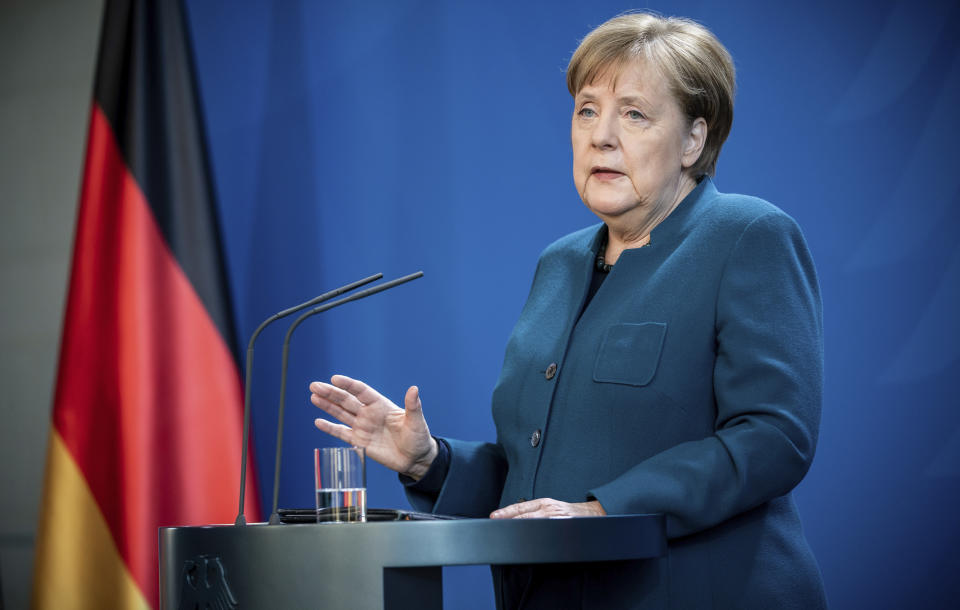 German Chancellor Angela Merkel speaks at a press conference about coronavirus, in Berlin, Sunday, March 22, 2020. German authorities have issued a ban on more than two people meeting outside of their homes, which they believe will be easier to follow than locking people in their homes. The vast majority of people recover from the new coronavirus. According to the World Health Organization, most people recover in about two to six weeks, depending on the severity of the illness. (Michael Kappeler/Pool photo via AP)