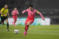 South Korea's Son Heung-min dribbles the ball against Turkmenistan during their Asian zone Group H qualifying soccer match for the FIFA World Cup Qatar 2022 at Goyang stadium in Goyang, South Korea, Saturday, June 5, 2021. (AP Photo/Lee Jin-man)