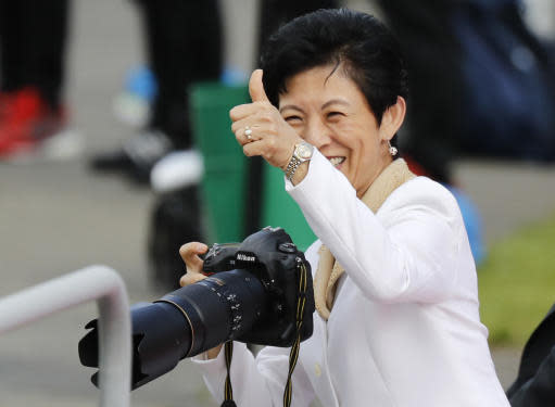Japan's Princess Takamado gestures as she photographs during a training session of Japan national team at the 2018 soccer World Cup in Kazan, Russia, Thursday, June 21, 2018. (AP Photo/Eugene Hoshiko)