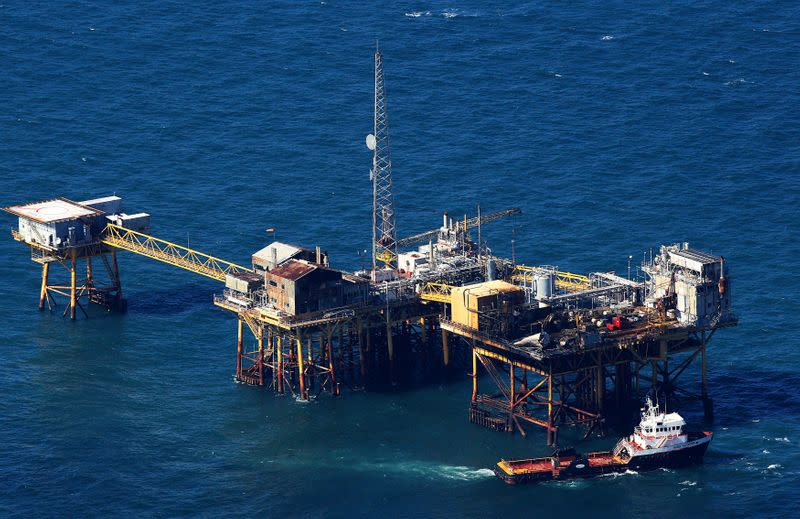 Oil firms evacuate staff, curb offshore production ahead of twin storms