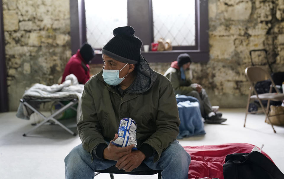 People seeking shelter from sup-freezing temperatures gather at a make-shift warming shelter at Travis Park Methodist Church, Tuesday, Feb. 16, 2021, in San Antonio. (AP Photo/Eric Gay)