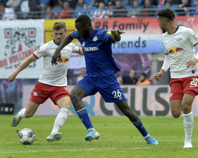 Leipzig's Timo Werner, left, and Schalke's Salif Sane, right, challenge for the ball during the German Bundesliga soccer match between RB Leipzig and FC Schalke 04 in Leipzig, Germany, Saturday, Sept. 28, 2019. (AP Photo/Jens Meyer)