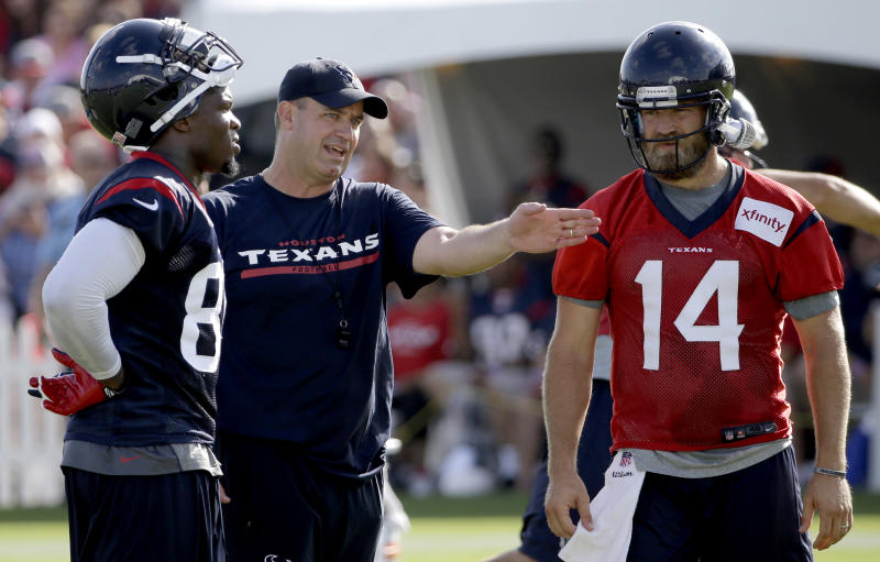 Houston Texans coach Bill O'Brien, center, talks with quarterback Ryan Fitzpatrick (14) and wide receiver Andre Johnson, left, during an NFL football training camp practice Sunday, July 27, 2014, in Houston