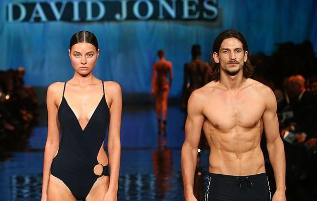 Jarrod is pictured showing off his incredible physique on the David Jones runway.