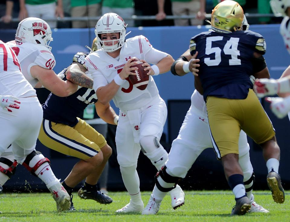 The pocket collapses around Wisconsin quarterback Graham Mertz (5) during the first quarter of their game Saturday, September 25, 2021 at Soldier Field in Chicago, Ill. Notre Dame beat Wisconsin 41-13.