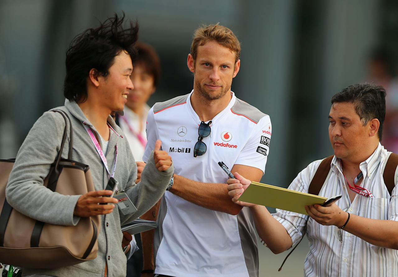 SUZUKA, JAPAN - OCTOBER 05:  Jenson Button of Great Britain and McLaren walks to the drivers briefing following practice for the Japanese Formula One Grand Prix at the Suzuka Circuit on October 5, 2012 in Suzuka, Japan.  (Photo by Clive Mason/Getty Images)