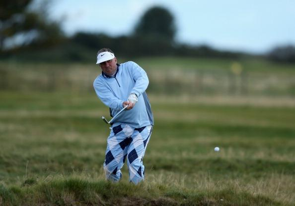 CARNOUSTIE, SCOTLAND - OCTOBER 05:  Former cricketer Sir Ian Botham hits a shot during the second round of the Alfred Dunhill Links Championship on The Championship Links at Carnoustie on October 5, 2012 in Carnoustie, Scotland.  (Photo by Richard Heathcote/Getty Images)