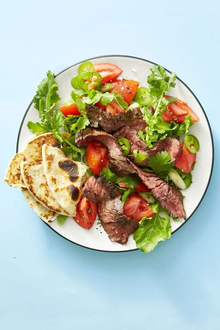 """<p>Satisfy your taco cravings with this salad recipe, then add tortilla slices to the plate when you're done mixing it all together!</p><p><em><a href=""""https://www.goodhousekeeping.com/food-recipes/easy/a19855342/grilled-steak-tortilla-salad-recipe/"""" rel=""""nofollow noopener"""" target=""""_blank"""" data-ylk=""""slk:Get the recipe for Grilled Steak Tortilla Salad »"""" class=""""link rapid-noclick-resp"""">Get the recipe for Grilled Steak Tortilla Salad »</a></em> </p><p><strong>RELATED</strong>: <a href=""""https://www.goodhousekeeping.com/food-recipes/healthy/g960/healthy-lunch-ideas/"""" rel=""""nofollow noopener"""" target=""""_blank"""" data-ylk=""""slk:Our Favorite Healthy Lunch Ideas"""" class=""""link rapid-noclick-resp"""">Our Favorite Healthy Lunch Ideas</a></p>"""