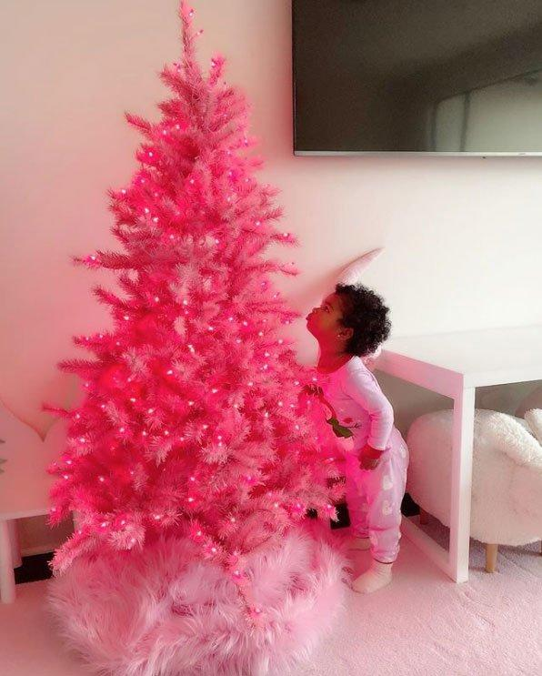 """Khloe kicked off the trimming in 2019 — with help from her daughter True!  The<em> Good American </em>designer revealed the first bit of Christmas decor that made it into her home: a bright pink faux fir, courtesy of theChristmas-loving family's go-to holiday decorator, Jeff Leatham. """"We starting decorating our house yesterday and @jeffleatham surprised True with this beautiful pink tree. It's safe to say that True loves it!!! Thankful and blessed beyond words!"""" Kardashian wrote alongside the adorable snapshot showing True seemingly giving the tree a smooch."""