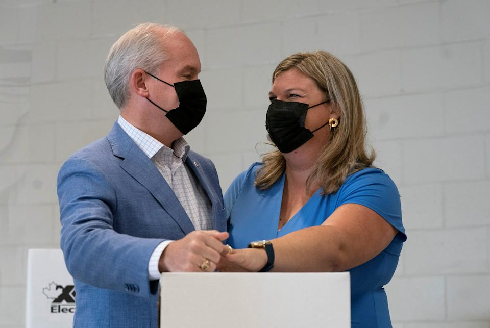 Canada's opposition Conservative Party leader Erin O'Toole and his wife Rebecca cast their ballots for the federal election, in Bowmanville, Ontario, Canada September 20, 2021. Adrian Wyld/Pool via REUTERS