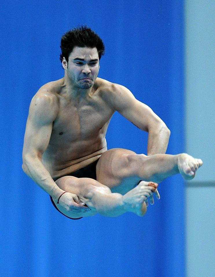 Alexandre Despatie of Canada competes in the men's 3m springboard diving finals at the Dr. S. P. Mukherjee Aquatics Complex during the Commonwealth Games  in New Delhi on October 11, 2010. Alexandre Despatie of Canada won the gold. AFP PHOTO/Prakash SINGH (Photo credit should read PRAKASH SINGH/AFP/Getty Images)