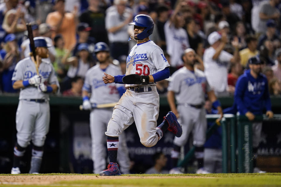 Los Angeles Dodgers' Mookie Betts scores on a single by Max Muncy during the seventh inning of a baseball game against the Washington Nationals, Friday, July 2, 2021, in Washington. (AP Photo/Julio Cortez)