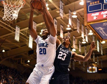 FILE PHOTO: Dec 8, 2018; Durham, NC, USA; Duke Blue Devils center Marques Bolden (20) pulls down a rebound in front of Yale Bulldogs forward Jordan Bruner (23) during the second half at Cameron Indoor Stadium. Mandatory Credit: Rob Kinnan-USA TODAY Sports - 11812831