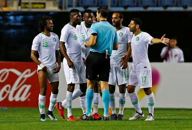 Soccer Football - International Friendly - Saudi Arabia v Algeria - Estadio Ramon de Carranza, Cadiz, Spain - May 9, 2018 Saudi Arabia's Yasser Al-Shahrani is shown a yellow card REUTERS/Marcelo Del Pozo