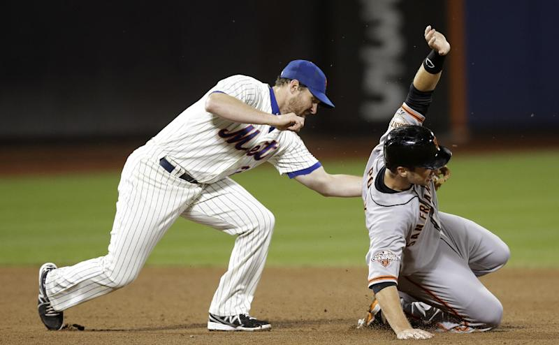 San Francisco Giants' Buster Posey, right, is safe stealing second as New York Mets second baseman Daniel Murphy, left, applies a late tag in the fifth inning of a baseball game on Wednesday, Sept. 18, 2013, in New York. AP Photo/Kathy Willens)