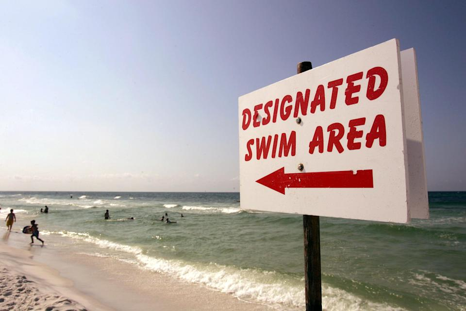 <p>A sign tells swimmers where they can swim on 3 July 2005 in Destin, Florida.</p> ((Getty Images))