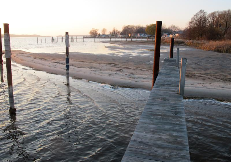 In this Nov. 16, 2012 photo, a sand bar is exposed by low water on Portage Lake in Onekama, Mich., which has made nearby docks and marinas largely unusable. The waterway is connected by a channel to nearby Lake Michigan, where levels are approaching record lows. The Great Lakes, the world's biggest freshwater system, are dropping because of drought and climbing temperatures, a trend that accelerated with this year's almost snowless winter and scorching summer. (AP Photo/John Flesher)