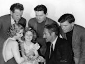 <p>Fox wasted no time in capitalizing on Shirley's adorable demeanor. By the end of 1934, she'd starred in seven major pictures, including <em>Bright Eyes</em>. Here, Shirley is seen with her adult costars in <em>Little Miss Marker, </em>Dorothy Dell, Charles Bickford, and Adolphe Menjou.</p>
