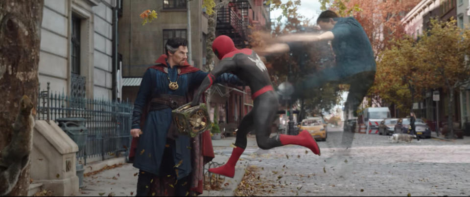 Doctor Strange ejects Peter Parker's astral projection from his Spider-Man body, while Peter holds a strange box