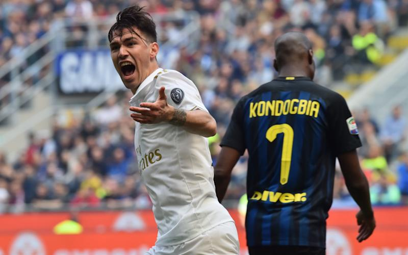 AC Milan's defender from Italy Alessio Romagnoli celebrates after scoring during the Italian Serie A football match Inter Milan vs AC Milan - Credit: GETTY