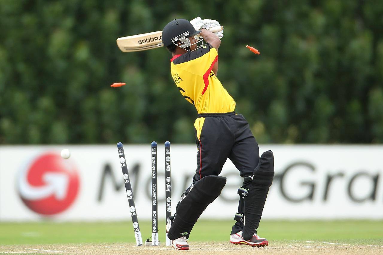 LINCOLN, NEW ZEALAND - JANUARY 30:  Lega Siaka of Papua New Guinea is bowled during the ICC Cricket World Cup Qualifier Semi Final match between Papua New Guinea and Hong Kong at Bert Sutcliffe Oval on January 30, 2014 in Lincoln, New Zealand.  (Photo by Martin Hunter-IDI/IDI via Getty Images)