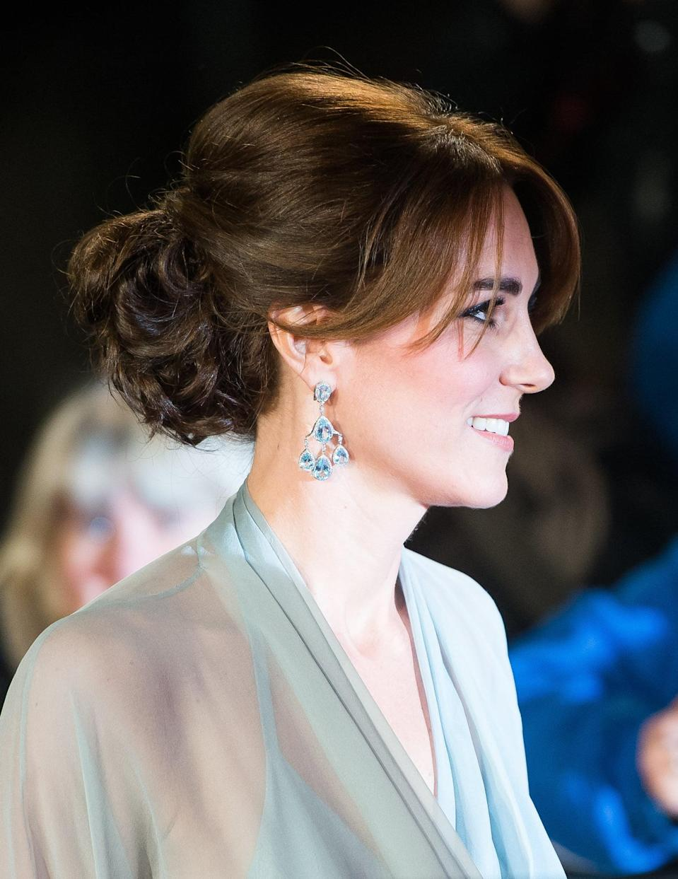 "<p>In case of ""the royals are just like us,"" Kate went and tried out bangs for a bit. Unlike the rest of us, she's got a professional hairstylist on call who can style them for her and iron out all the cowlicks. Regardless, her mid-length fringe really suits her, worn here for an event at Royal Albert `hall with a middle part and a low, curly updo. </p>"