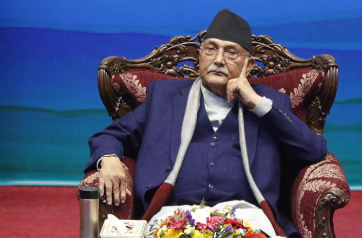 Nepalese Prime Minister Khadga Prassad Oli attends a signing of peace agreement in Kathmandu, Nepal, Friday, March 5, 2021. Leader of Nepal Communist Party group Netra Bikram Chand, who is better known by his guerrilla name Biplav, emerged out of hiding on Friday after the government lifted a ban on his group so it could take part in the public signing of the peace agreement. This group had split from the Maoist Communist party, which fought government troops between 1996 and 2006, when it gave up its armed revolt, agreed to U.N.-monitored peace talks and joined mainstream politics. (AP Photo/Niranjan Shrestha)