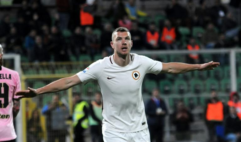 Roma's forward from Bosnia-Herzegovina Edin Dzeko celebrates after scoring during the Italian Serie A football match Palermo vs AS Roma, on March 12, 2017