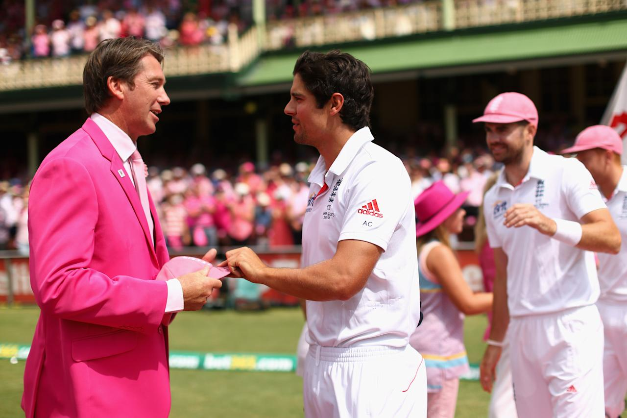 SYDNEY, AUSTRALIA - JANUARY 05: England captain Alastair Cook presents a pink cap to former Australian cricketer Glenn McGrath on Jane McGrath Day during day three of the Fifth Ashes Test match between Australia and England at Sydney Cricket Ground on January 5, 2014 in Sydney, Australia.  (Photo by Cameron Spencer/Getty Images)