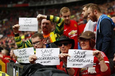 Britain Football Soccer - Manchester United v Swansea City - Premier League - Old Trafford - 30/4/17 Manchester United's fans hold up banners Action Images via Reuters / Jason Cairnduff Livepic