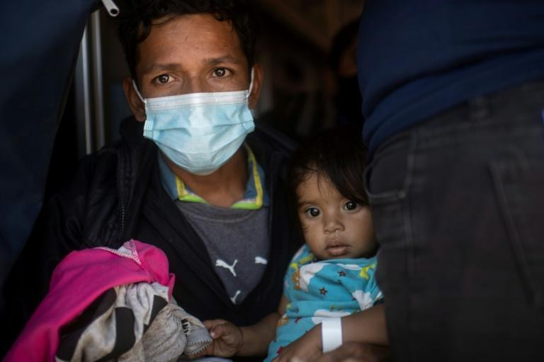 A mother and her child are deported from the United States to Mexico via the Paso del Norte border bridge