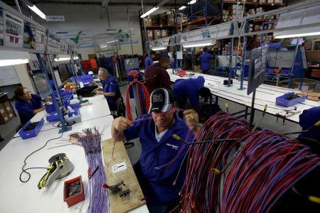 FILE PHOTO: Employees work at a wire harness and cable assembly manufacturing company that exports to the U.S., in Ciudad Juarez, Mexico, April 27, 2017. REUTERS/Jose Luis Gonzalez/File Photo