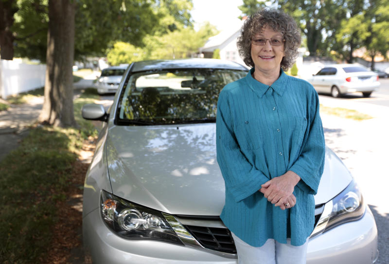 """Cindy Shriner, a retired teacher, poses for a portrait with her 2009 Subaru Impreza in Lafayette, Ind., Saturday, June 9, 2012. Shriner buys energy-efficient light bulbs and her car gets nearly 30 miles per gallon on the highway. Still, she keeps her house at about 73 degrees year-round, despite government recommendations to turn thermostats to 68 degrees in winter and 78 degrees in summer. """"I'm terrible,"""" Shriner, 60, said in an interview. """"In all honesty we have extreme weather in all seasons"""" in Indiana, she said, and her thermostat settings keep her comfortable. A new poll shows that while most of those questioned understand effective ways to save energy, they have a hard time adopting them. (AP Photo/AJ Mast)"""