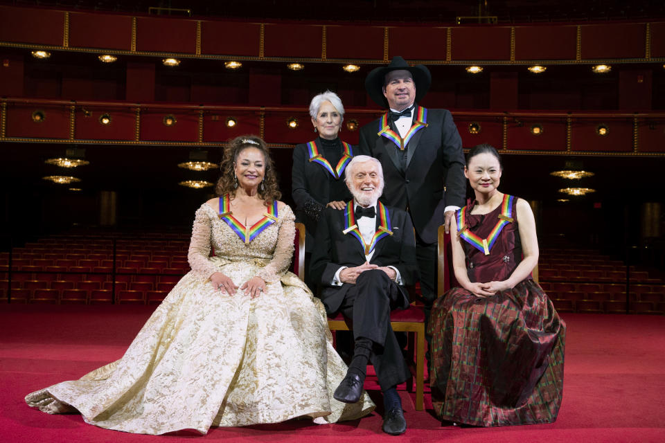 2020 Kennedy Center honorees, from left, choreographer, and actress Debbie Allen; singer-songwriter and activist Joan Baez; actor Dick Van Dyke; country singer-songwriter Garth Brooks; and violinist Midori pose for a group photos at the 43nd Annual Kennedy Center Honors at The Kennedy Center on Friday, May 21, 2021, in Washington. (AP Photo/Kevin Wolf)