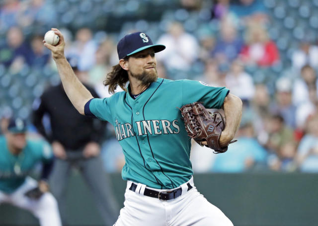 Mariners' right-hander Mike Leake bounced back from worst career start to throw near perfect game against the Angels. (AP Photo/Ted S. Warren)
