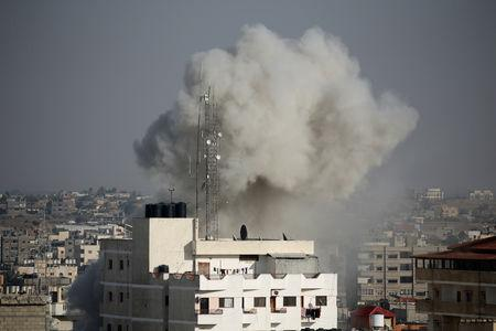 Smoke rises during an Israeli air strike in the southern Gaza Strip May 5, 2019. REUTERS/Ibraheem Abu Mustafa