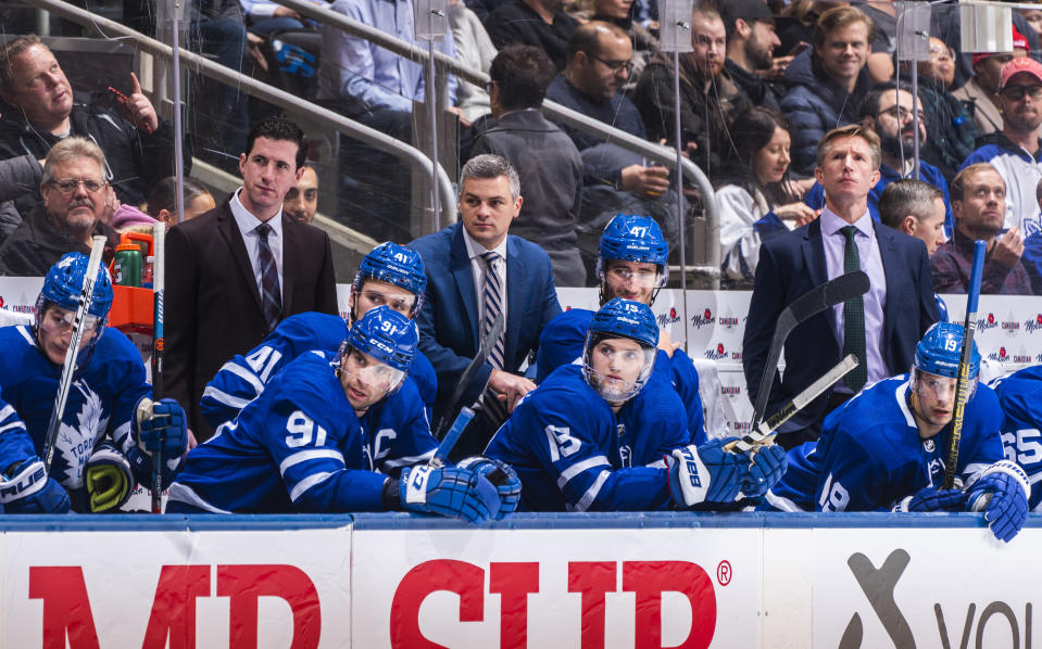 TORONTO, ON - DECEMBER 4: Head coach Sheldon Keefe, assistant coach Paul McFarland, and assistant coach Dave Hakstol of the Toronto Maple Leafs watch from the bench against the Colorado Avalanche during the third period at the Scotiabank Arena on December 4, 2019 in Toronto, Ontario, Canada. (Photo by Mark Blinch/NHLI via Getty Images)