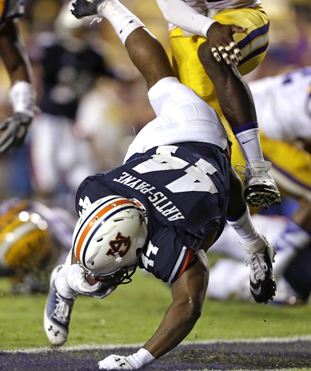 Auburn running back Cameron Artis-Payne (44) scores a touchdown in the second half of an NCAA college football game against LSU in Baton Rouge, La., Saturday, Sept. 21, 2013. LSU won 35-21. (AP Photo/Gerald Herbert)